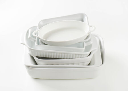 Stacked baking dishes of various sizes and shapes photo