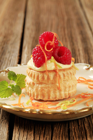 puff pastry: Custard filled puff pastry shell topped with raspberries