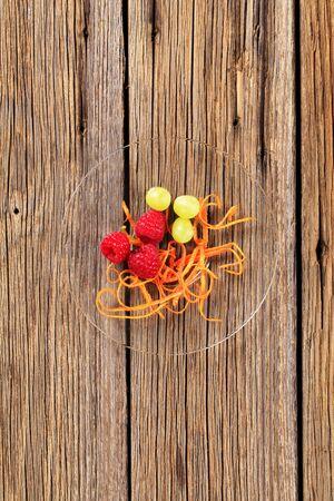 garnish: Fruit garnish - Raspberries, grapes and orange peel