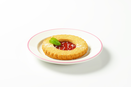red currant: Single whole wheat Linzer cookie filled with red currant preserve Stock Photo