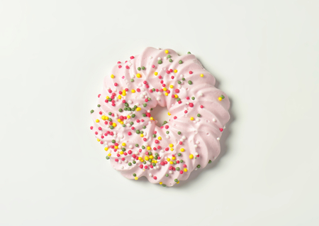 sprinkles: Wreath-shaped meringue cookie topped with sprinkles Stock Photo
