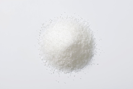 granulated: Heap of white granulated sugar