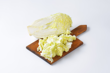napa: Chopped napa cabbage on cutting board Stock Photo