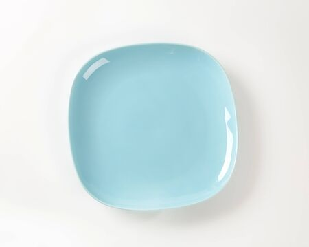 shallow: Shallow light blue porcelain square plate Stock Photo