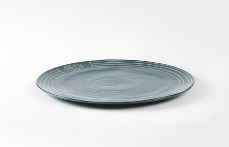 stoneware: Handcrafted ceramic plate with engraved symbols