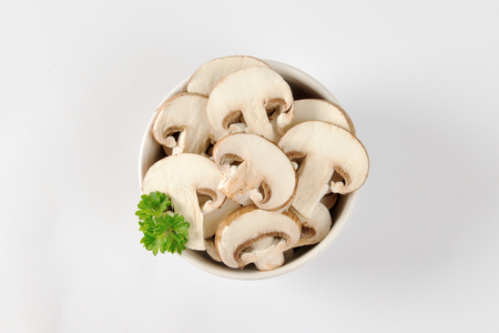 edible mushroom: Bowl of sliced fresh mushrooms