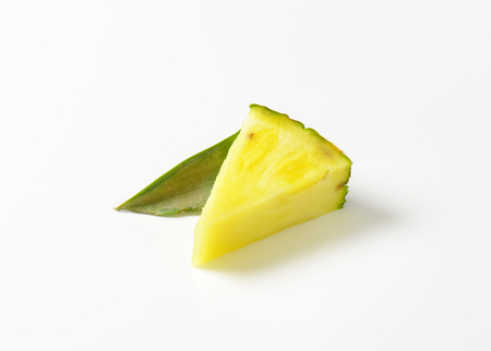 wedge: Fresh pineapple wedge on white background Stock Photo