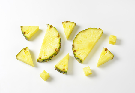 pieces: Fresh pineapple slices and wedges - studio shot Stock Photo