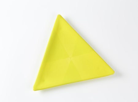 entree: Small plain yellow triangle plate - great fot appetizers and entree dishes