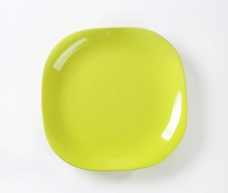 yellow green: Square shaped yellow green  plate with rounded corners