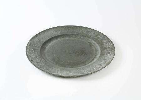 rimmed: Wide rimmed gray dinner plate Stock Photo