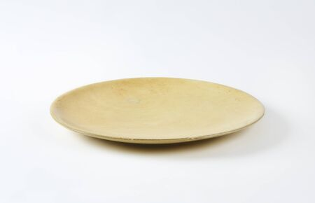 rimless: Beige flat rimless dinner plate Stock Photo
