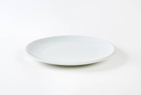 Contemporary plain white dinner plate