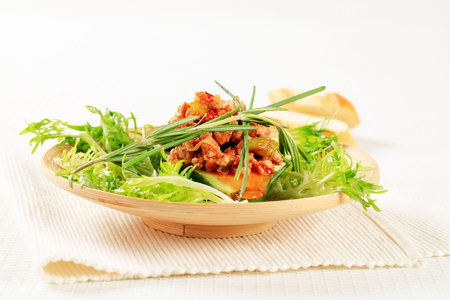salad greens: Avocado stuffed with minced meat garnished with salad greens