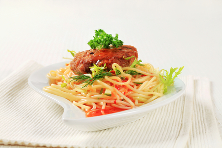 Meat patty with spaghetti and spicy sauce Stock Photo
