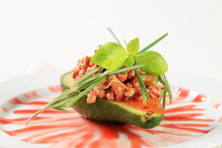 stir fried: Avocado stuffed with stir fried minced meat Stock Photo