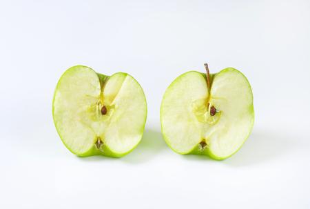 halved  half: Halved fresh juicy green apple Stock Photo