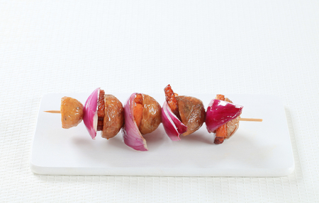 spanish onion: Bacon and potato skewer with Spanish onion