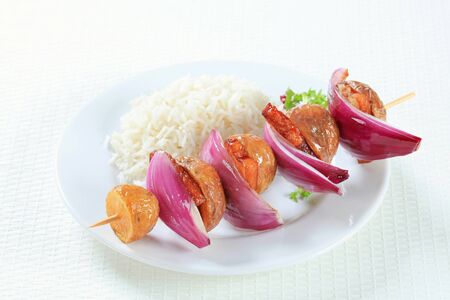 Bacon and potato skewer with white rice photo
