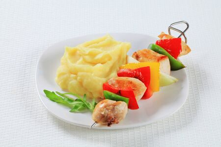 Chicken skewer served with mashed potato photo