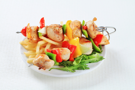 Chicken Shish kebabs with French fries photo