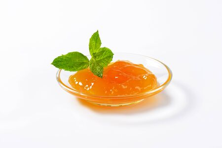 glass plate: Apricot jam on small glass plate Stock Photo