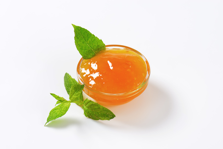 apricot jam: Apricot jam in small glass bowl