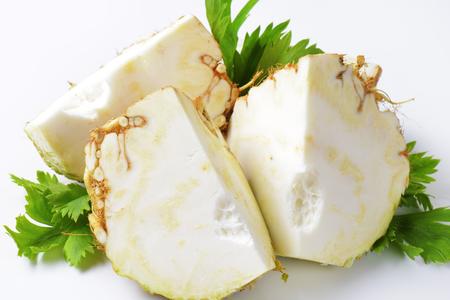 apium graveolens: Fresh celeriac cut in thirds