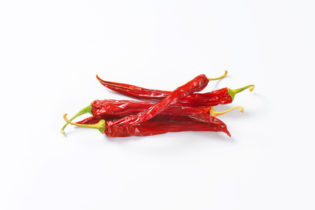 long shots: Dried Red Chili Peppers on white background Stock Photo