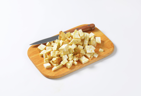 apium graveolens: Diced celery root on cutting board