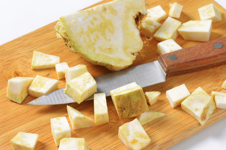 apium graveolens: Diced celery root on cutting board