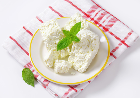 crumbly: Crumbly white cheese on plate