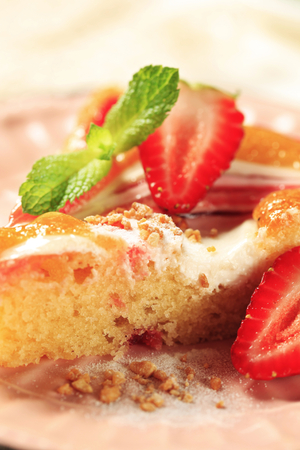 Sponge cake with cream cheese and strawberry sauce photo