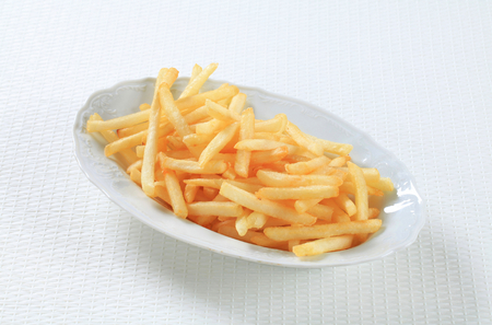french fries plate: Portion of French fries in a plate Stock Photo
