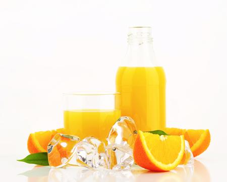 multivitamin: Fresh orange juice and ice Stock Photo