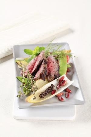 garnish: Slices of roast beef  and vegetable garnish