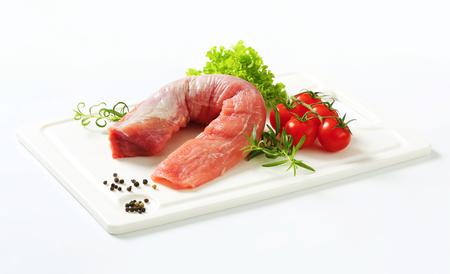 pork tenderloin: Raw pork tenderloin on cutting board