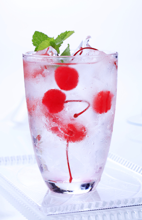 maraschino: Glass of iced drink with maraschino cherries