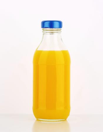 multivitamin: Bottle of orange juice - studio shot