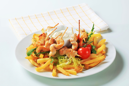 pomme: Chicken satay with French fries and tartar sauce Stock Photo