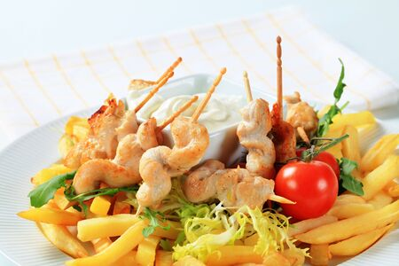 satay sauce: Chicken satay with French fries and tartar sauce Stock Photo