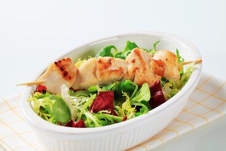 salad greens: Chicken skewer and mixed salad greens