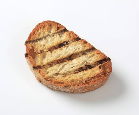 crunchy: One slice of crunchy grill toasted bread Stock Photo