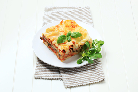 Portion of lasagna on a plate Stock Photo