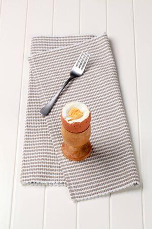 eggcup: Boiled egg in a wooden eggcup