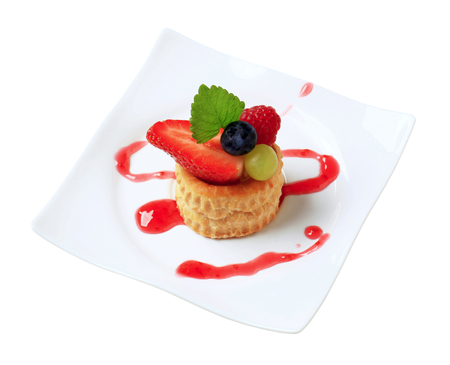 puff pastry: Custard filled puff pastry shell topped with berry fruit Stock Photo
