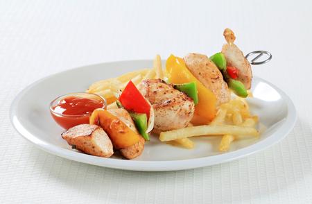 the shish kebab: Chicken Shish kebab with French fries and ketchup Stock Photo