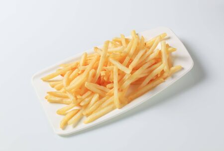 french fries plate: Portion of French fries on plastic plate