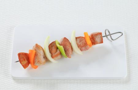 the shish kebab: Shish kebab on cutting board Stock Photo