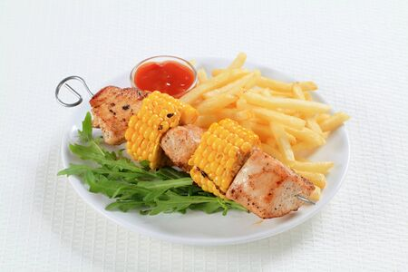 sweetcorn: Turkey and sweetcorn skewer with French friesand ketchup